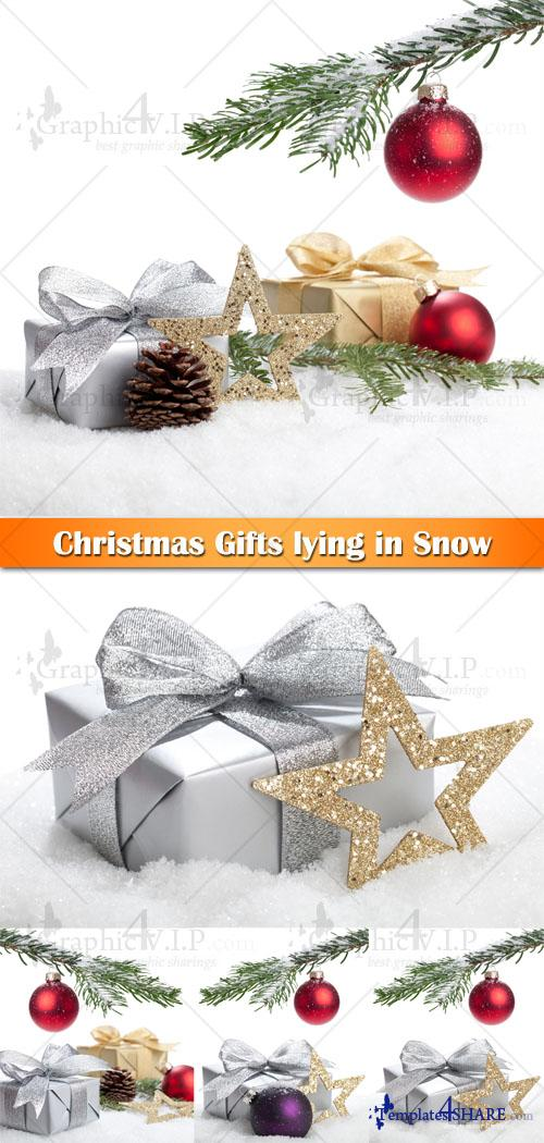 Christmas Gifts lying in Snow - Stock Photos